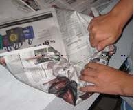 """roll-newspaper-2"""