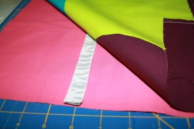 Place_Ribbon_Between_Fabric_Squares