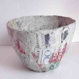 Cover with newspaper strips